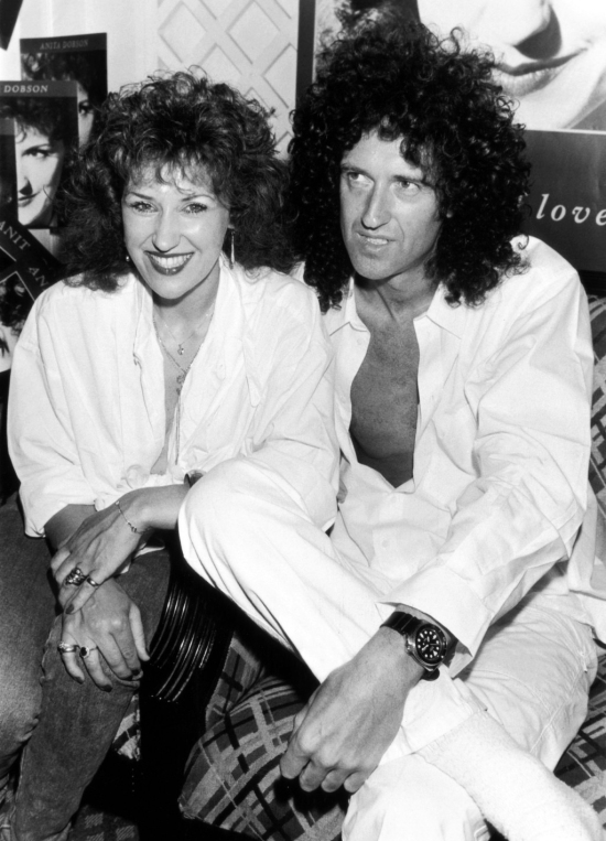 Actress Anita Dobson of the soap-opera 'Eastenders' with Queen guitarist Brian May at a party to celebrate the release of their first single 'Talking of Love', July 1987. The pair were later married.