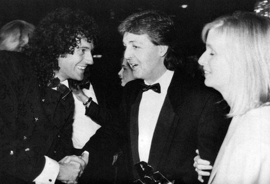 Brian May at the British Video Awards at Grosvenor House Hotel, London on 16th October 1986. Queen win the Favourite Music Video with 'Live In Rio'. Photographed here with Paul and Linda McCartney.