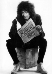 Brian May with newspaper