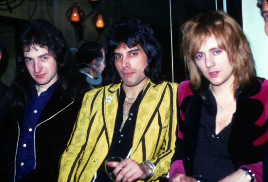 Freddie, John and Roger attend an after show party in their honour at Le Poulailler, an elegant restaurant near the Lincoln Centre in New York City. This was during the 'Invite You To A Night At The Opera' tour of the USA in Februar