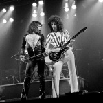 Freddie Mercury and Brian May on stage in 70's