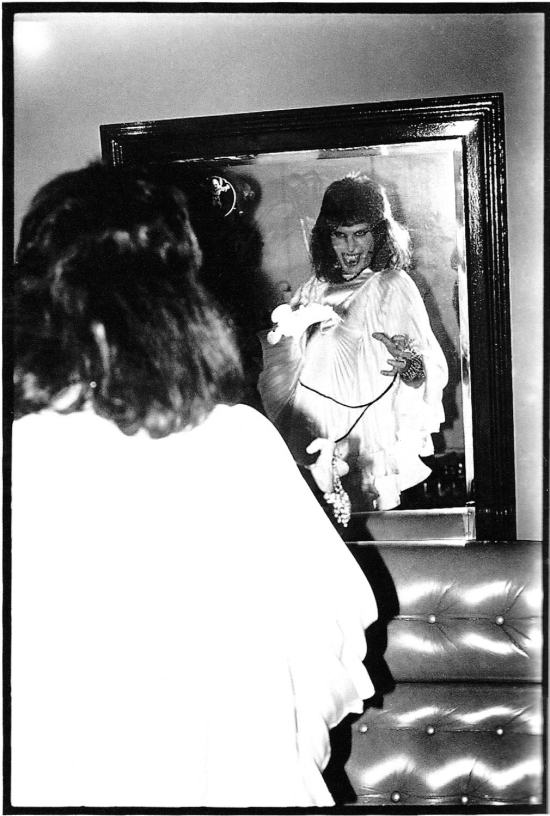 Freddie Mercury backstage (Photo by Mick Rock)