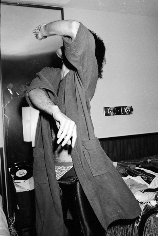 Freddie Mercury in a bedroom during a tour, circa 1977 (3)