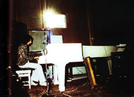 Freddie Mercury playing the piano