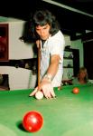 Freddie Mercury playing pool at Ridge Farm, 1975.