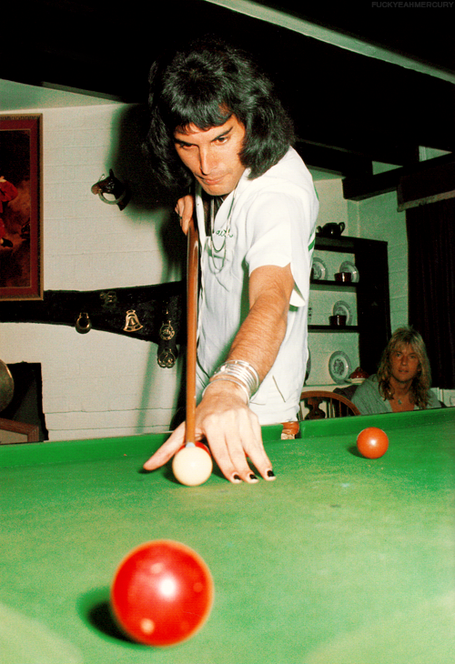 Freddie Mercury playing pool at Ridge Farm, 1975.