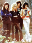 Queen toured Japan in March  April 1976, their second visit to that country. This shot was taken by Koh Hasebe at a photo session in a Japanese garden.