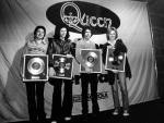 Queen with gold discs