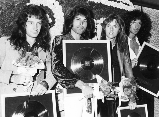 Receiving awards at a press conference in Tokyo on Queen's first tour of Japan in April 1975, photographed by Koh Hasebe