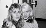 Roger Taylor and Blondie's singer Debbie Harry at Bel Air Hotel, Los Angeles, California, 1977. Picture by Jenny Lens.