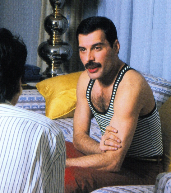 Freddie Mercury being interviewed in Japan in May 1985. Photo by Koh Hasebe.