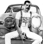 Freddie sitting on car