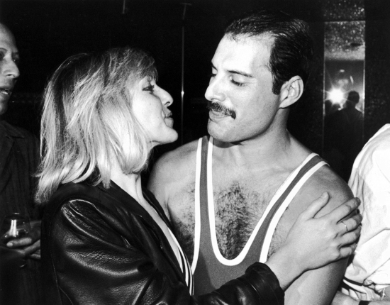 Freddie with Mary Austin. Mercury's 38th Birthday party at Xenon in London 002