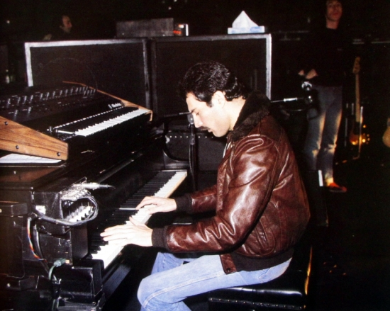 Freddie with Peter Hince at soundcheck in LA, 1980