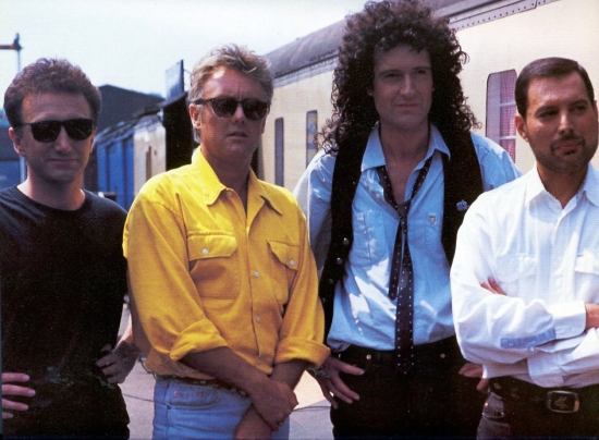 A photo session while filming the promotional video for 'Breakthru' at Nene Valley Railway, Cambridgeshire, England in June 1989