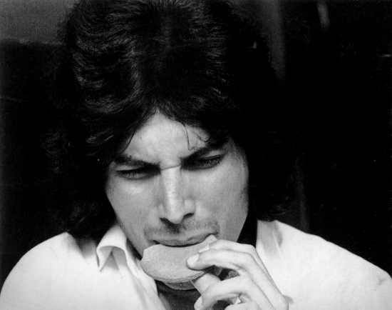 A young Freddie eating a biscuit at Ealing College of Art, circa 1969