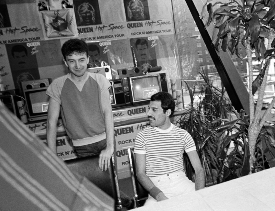 Musicians John Deacon and Freddie Mercury of Queen attend Queen Press Conference on July 27, 1982 at Crazy Eddie's in New York City
