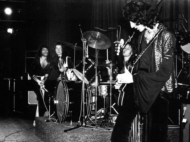Queen playing live at Imperial College, London, England on 2nd November 1973. Photo by Mick Rock.