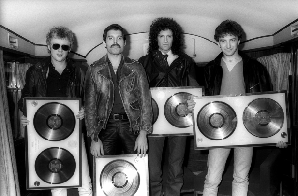 Queen receiving gold disc awards for 'Greatest Hits' on a train in Holland on 25 April 1982. Photo by Rob Verhorst.