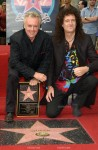QUEEN stars ROGER TAYLOR (left) & BRIAN MAY on Hollywood Boulevard where the rock group was honored with the 2,207th star on the Hollywood Walk of Fame..18OCT2002.