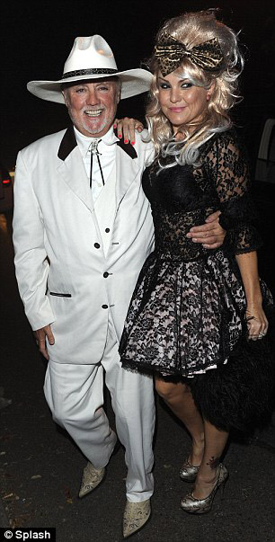 Pułkownik Sanders i Dolly Parton; 1 października 2011 r.; fot.: queenconcerts.com